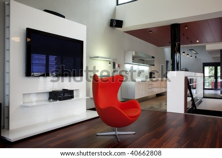 red armchair in modern apartment - stock photo