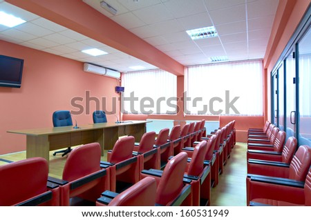 Red armchairs in a meeting room