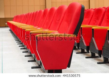 Red armchairs in the conference hall