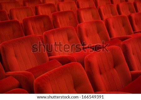 Red armchairs in theater - stock photo