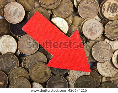 Red Arrow Down on the Russian Coins Background - stock photo