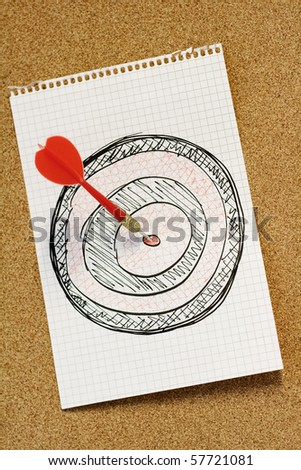 Red arrow hitting bull's eye of hand drawn dartboard - stock photo