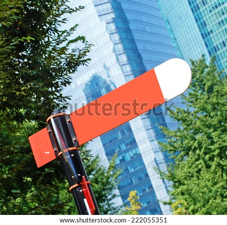 red arrow on a background of houses - stock photo