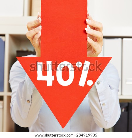 Red arrow with 40% discount being held by female hands - stock photo