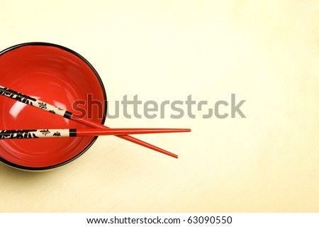 Red asian style bowl on silk background.