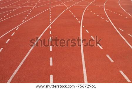 Red asphalt running track. - stock photo