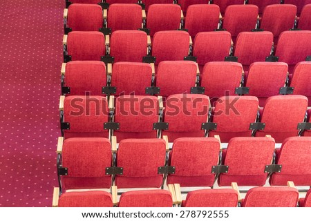 Red auditorium chairs - no people