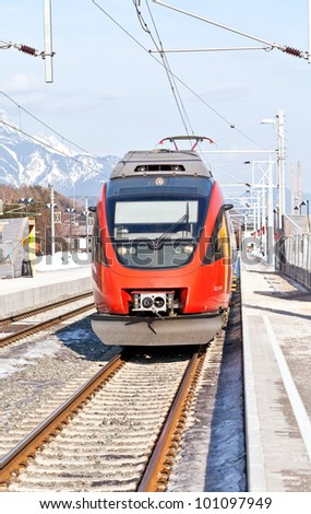 Red Austrian train at the platform - stock photo