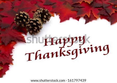 Red Autumn Leaves and a Pine Cones Background isolated on white with text Happy Thanksgiving, Autumn Time Happy Thanksgiving - stock photo