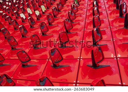 red background in the form of automobile mirrors - stock photo