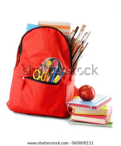 Red backpack with colourful stationary and pile of books with an apple on the top isolated on white background - stock photo