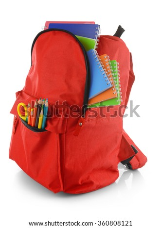 Red backpack with colourful stationary isolated on white background