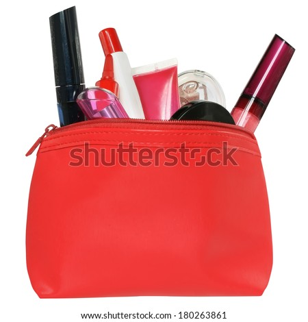 Red bag for cosmetics with a make up accessories on a white background. - stock photo