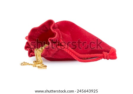 Red bag with gold necklace,Chinese New Year background. - stock photo