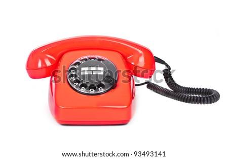 red bakelite phone on white background - stock photo