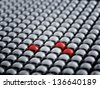 Red ball among white spheres, standing out in the crowd concept - stock photo