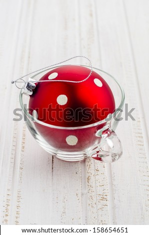 red ball in a transparent cup on Christmas - stock photo