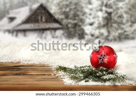 red ball tree of xmas time and snow on top  - stock photo