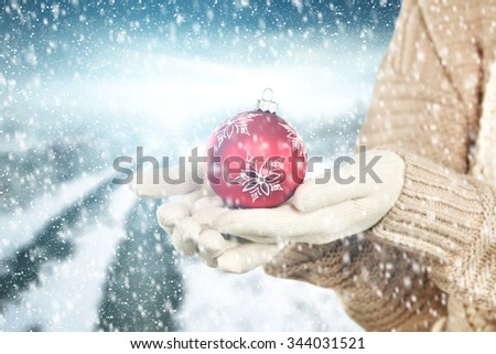 red ball woman and free space and space of snow  - stock photo