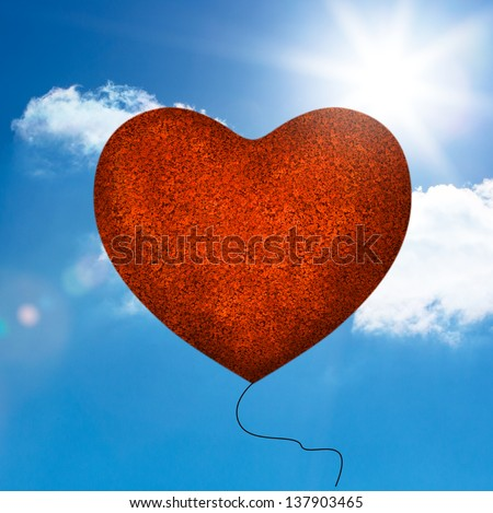 Red balloon heart shape floating in the sky