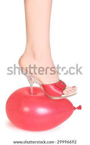 red balloon under spike heel - stock photo