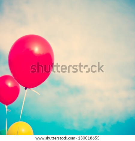 Red Balloons and Turquoise Sky - stock photo