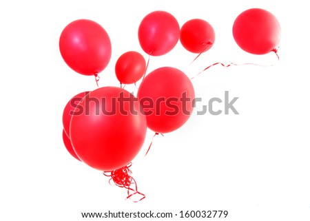 Red balloons with ribbons isolated on a white background. - stock photo