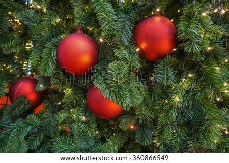 Red balls decoration on christmas tree - stock photo