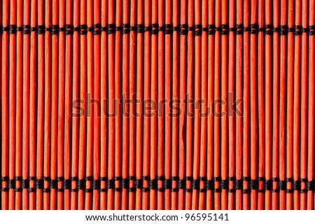 red bamboo table cloth background - stock photo