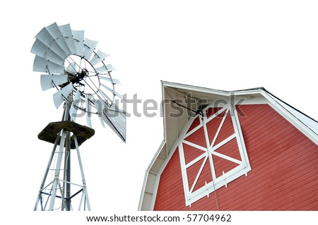 Red barn and metal windmill isolated on white background.