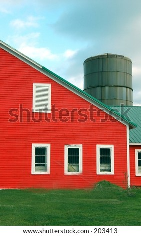 Red barn and silio - stock photo