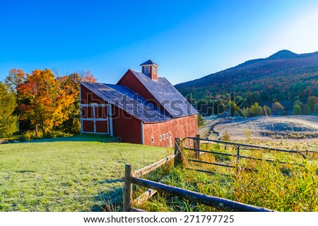 Red barn during a New England fall foliage, Stowe, Vermont, USA - stock photo