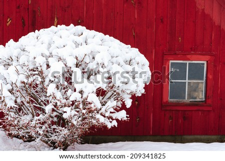 Red barn during winter with snow, Stowe, Vermont, USA - stock photo