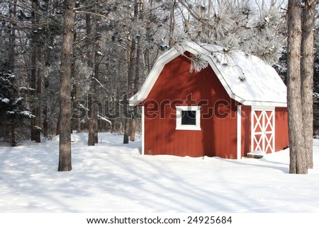 red barn in a winter setting