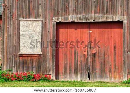 Red Barn in Need of Repainting - stock photo