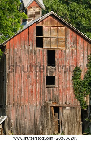 Red Barn in Need of Repair - stock photo