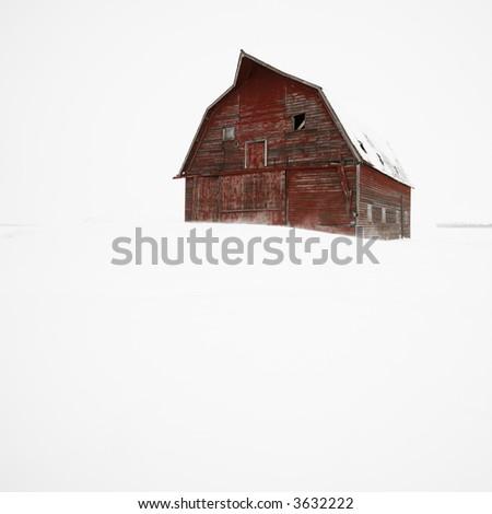 Red barn in winter landscape. - stock photo