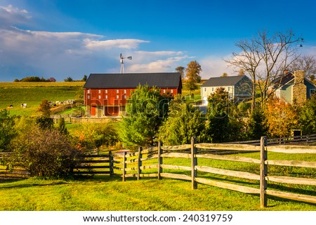 Red barn on a farm in rural York County, Pennsylvania. - stock photo