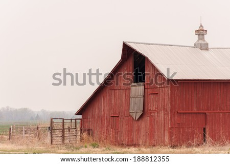 Red Barn on the Prairie - stock photo