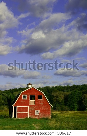 Red barn with a blue sky behind it