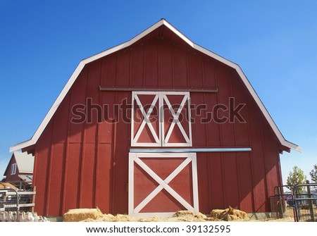 Red Barn with Blue Sky Background - stock photo