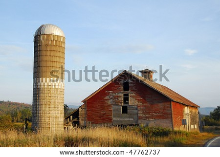 Red Barn with Grain Silo - stock photo