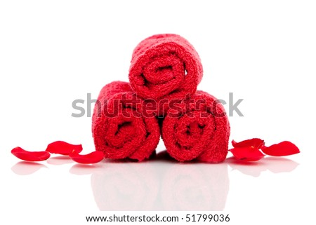 Red bath towels on white background