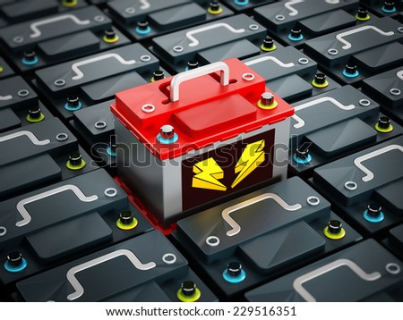 Red battery stands out among regular gray car batteries - stock photo