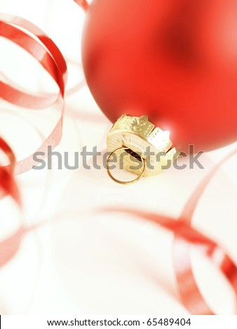 Red bauble and red ribbon - stock photo