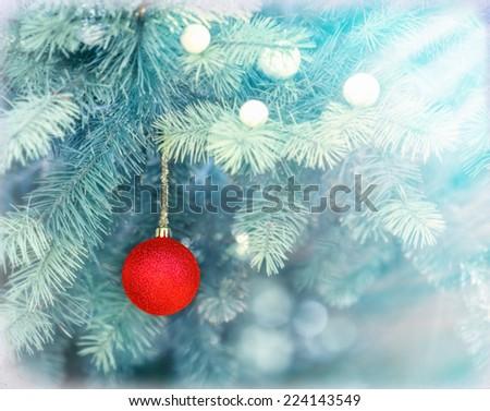 Red bauble on Christmas tree (xmas ball) - stock photo