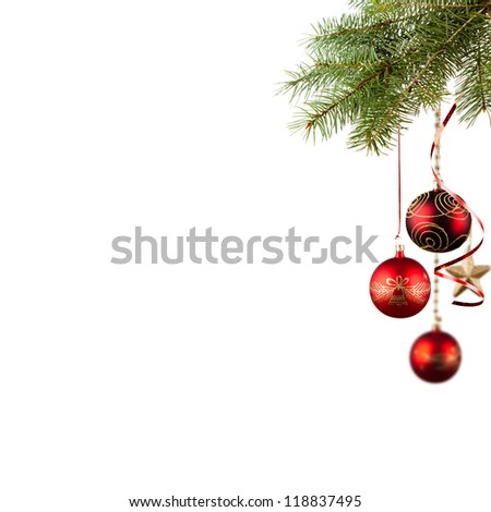 Red baubles on green christmas firtree on white background - stock photo