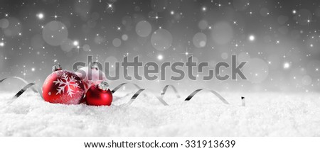 Red Baubles On Snow With Sparkling Stars On Silver Background  - stock photo