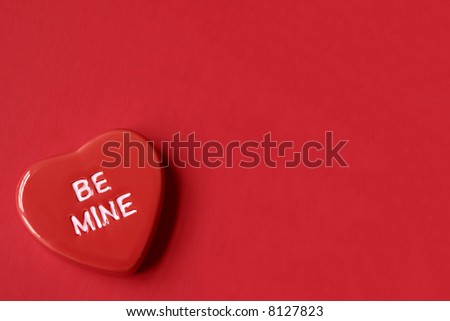 Red Be Mine Heart on Red Background with Room for Copy Space - stock photo