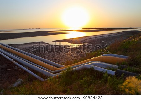 Red Beach on the oil pipeline - stock photo